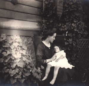 There was no information on the back of this photo of Ursula (on Mama's lap). Perhaps she was tuckered out after a party like the one at which she greeted guests in January 1908.