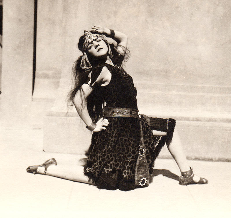 "Ursula poses in costume for a photographer ostensibly taking publicity pictures for  ""Nero,"" a Roman tragedy produced by the English Club at UC Berkeley around 1922"