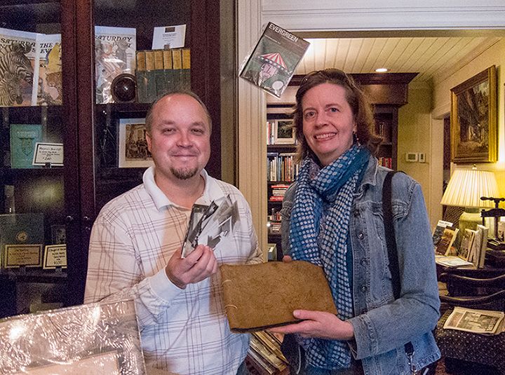 At Yeoman's in the Fork: Mike Cotter and me holding the newly discovered album and loose photos
