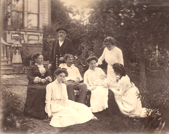In black: Grandma and Grandpa Uphoff. In white, seated in chairs: Alfred, Clara and baby Ursula; and Ursula's aunts