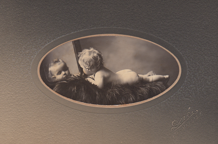 Baby Ursula lounges in style, 1902 or '03